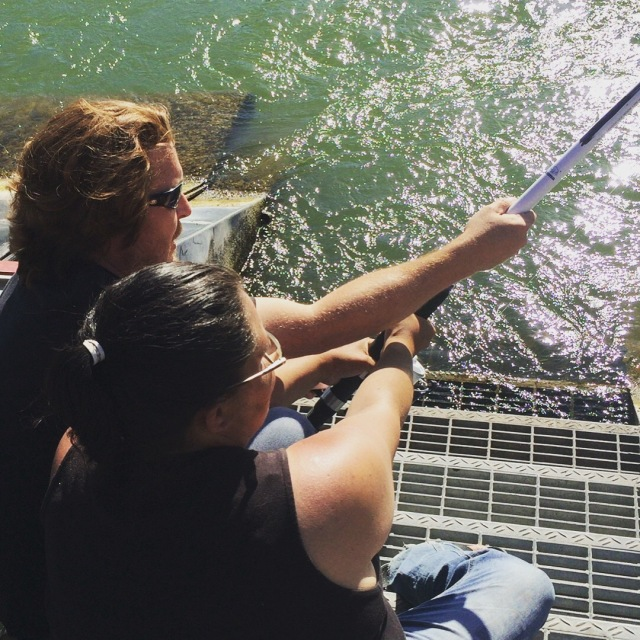 My wife Natalie and I working to land a White Sturgeon.